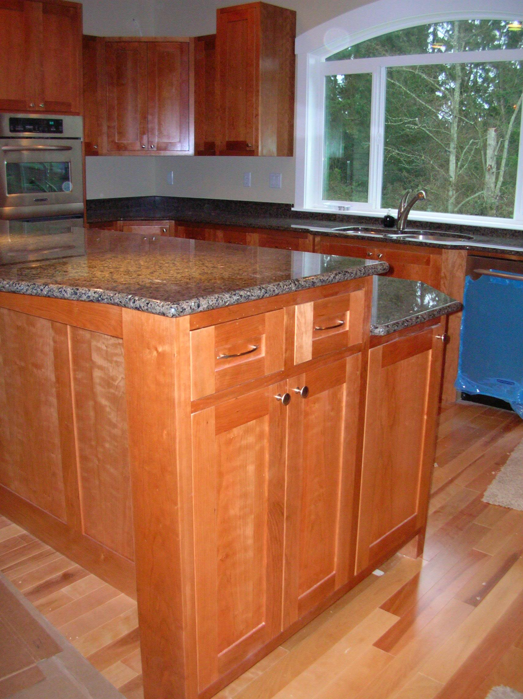 Cherry wood 2 custom made kitchen cabinets and remodels for Custom made kitchen cupboards